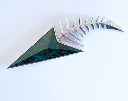 chrsocollar and silver brooch